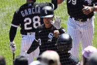 Chicago White Sox's Jake Lamb, center, celebrates after he hit a two-run home run during the third inning of the first baseball game of a doubleheader against the Baltimore Orioles, Saturday, May 29, 2021, in Chicago. (AP Photo/Matt Marton)