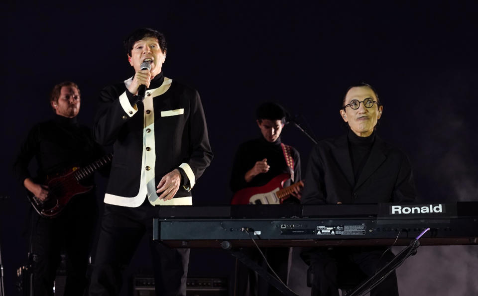 """Russell Mael, second from left, and his brother Ron, far right, of the band Sparks perform before a special screening of the film """"Annette"""" at the Hollywood Forever Cemetery, Aug. 18, 2021 - Credit: Chris Pizzello/Invision/AP"""