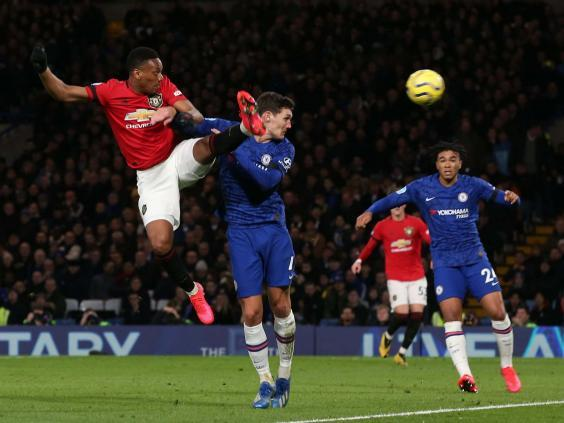 Anthony Martial heads United in front at Stamford Bridge (PA)