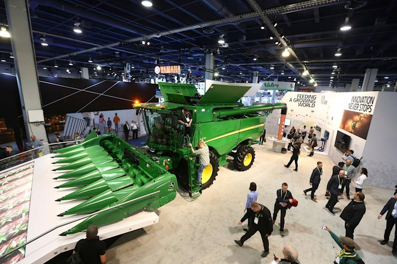 FILE- In this Jan. 8, 2019, file photo a John Deere combine harvester is displayed at CES International in Las Vegas. Deere & Co. reports earns on Friday, Feb. 15, 2019. (AP Photo/Ross D. Franklin, File)
