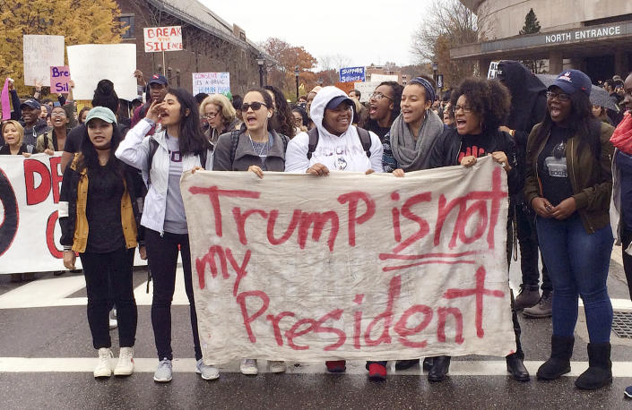 <p>People protest on the University of Connecticut campus against the election of Republican Donald Trump as President Wednesday, Nov. 9, 2016, in Storrs, Conn. (AP Photo/Pat Eaton-Robb) </p>