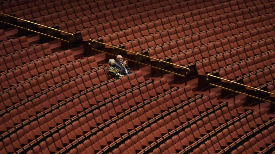 People attend The Church of Jesus Christ of Latter-day Saints' twice-annual church conference Saturday, Oct. 2, 2021, in Salt Lake City. The Utah-based faith has repeatedly encouraged its 16 million members worldwide to limit the spread by getting vaccines and wearing masks. The conference is taking place again without full attendance due to the pandemic. For the first time in two years, though, leaders were back at the faith's 20,000-seat conference center, with several hundred people watching in person. (AP Photo/Rick Bowmer)