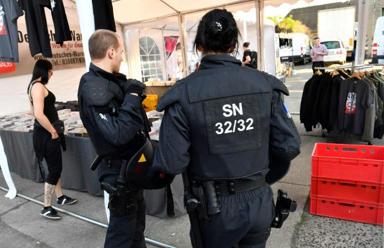 Police officers inspect the premises at the Shield and Sword neo-nazi festival in the eastern German town of Ostritz where hundreds of neo-Nazis were gathering on April 20, 2018, which marks Adolf Hitler's birthday