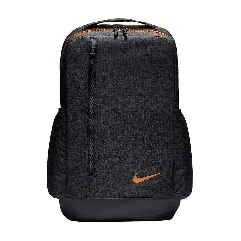 """<p><strong>Nike</strong></p><p>amazon.com</p><p><strong>$89.90</strong></p><p><a href=""""https://www.amazon.com/dp/B07GKBJQD2?tag=syn-yahoo-20&ascsubtag=%5Bartid%7C2089.g.1214%5Bsrc%7Cyahoo-us"""" rel=""""nofollow noopener"""" target=""""_blank"""" data-ylk=""""slk:Shop Now"""" class=""""link rapid-noclick-resp"""">Shop Now</a></p><p>This is a sleek bag that will take up hardly any space on public transportation. It has a large compartment for storing your belongings, plus a laptop sleeve and side pockets for water bottles and a post-workout protein shake or travel coffee mug. The straps come with some solid cushioning, so your shoulders won't be burdened from carrying this bag for a full day.</p>"""