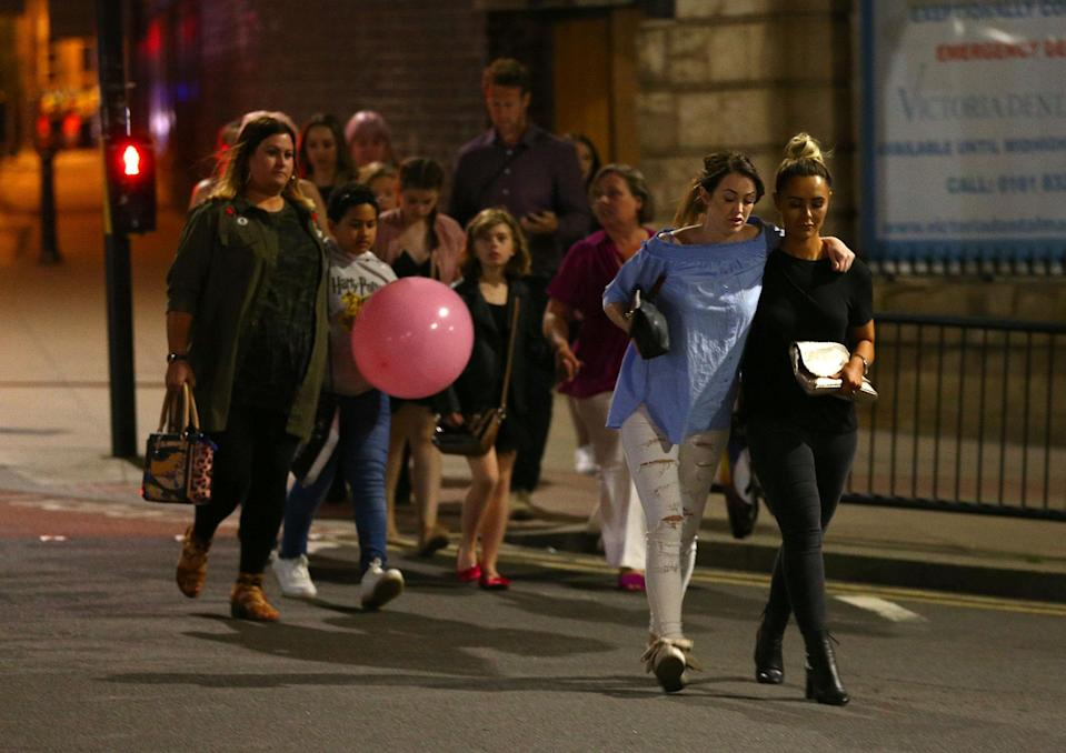 <p>Members of the public are escorted from the Manchester Arena on May 23, 2017 in Manchester, England. There have been reports of explosions at Manchester Arena where Ariana Grande had performed this evening. Greater Manchester Police have have confirmed there are fatalities and warned people to stay away from the area. (Dave Thompson/Getty Images) </p>