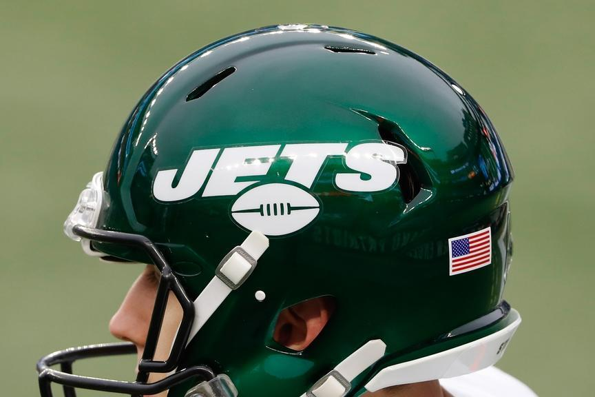 2020 Jets logo on green helmet during game