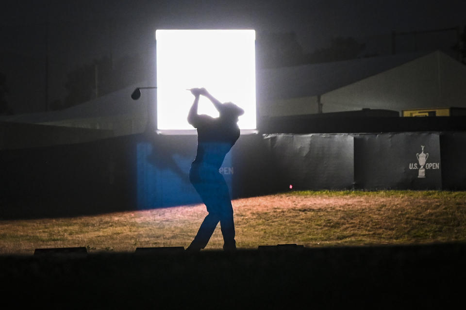 SAN DIEGO, CA - JUNE 17:  Bryson DeChambeau is silhouetted as he hits balls at night on the practice range after play following the first round of the 121st U.S. Open on the South Course at Torrey Pines Golf Course on June 17, 2021 in La Jolla, San Diego, California. (Photo by Keyur Khamar/PGA TOUR via Getty Images)