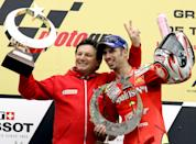 <p>Fortuna Honda Team Moto GP rider Marco Melandri of Italy celebrates with his team manager Fausto Gresini, left, at the Istanbul Park race track in Istanbul, Turkey, Sunday, April 30, 2006, during a ceremony at the end of the MotoGP Turkish Grand Prix. Marco Melandri of Italy won the Turkish Grand Prix in Istanbul, displaying his mastery of a course he also won last year. Melandri passed Moto GP rookie Casey Stoner of Australia on the last lap. (AP Photo/Murad Sezer)</p>