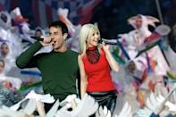 Singers Christina Aguilera (R) and Enrique Iglesias (L) perform during the halftime show at Super Bowl XXXIV at the Georgia Dome in Atlanta, 30 January, 2000. (JEFF HAYNES/AFP via Getty Images)