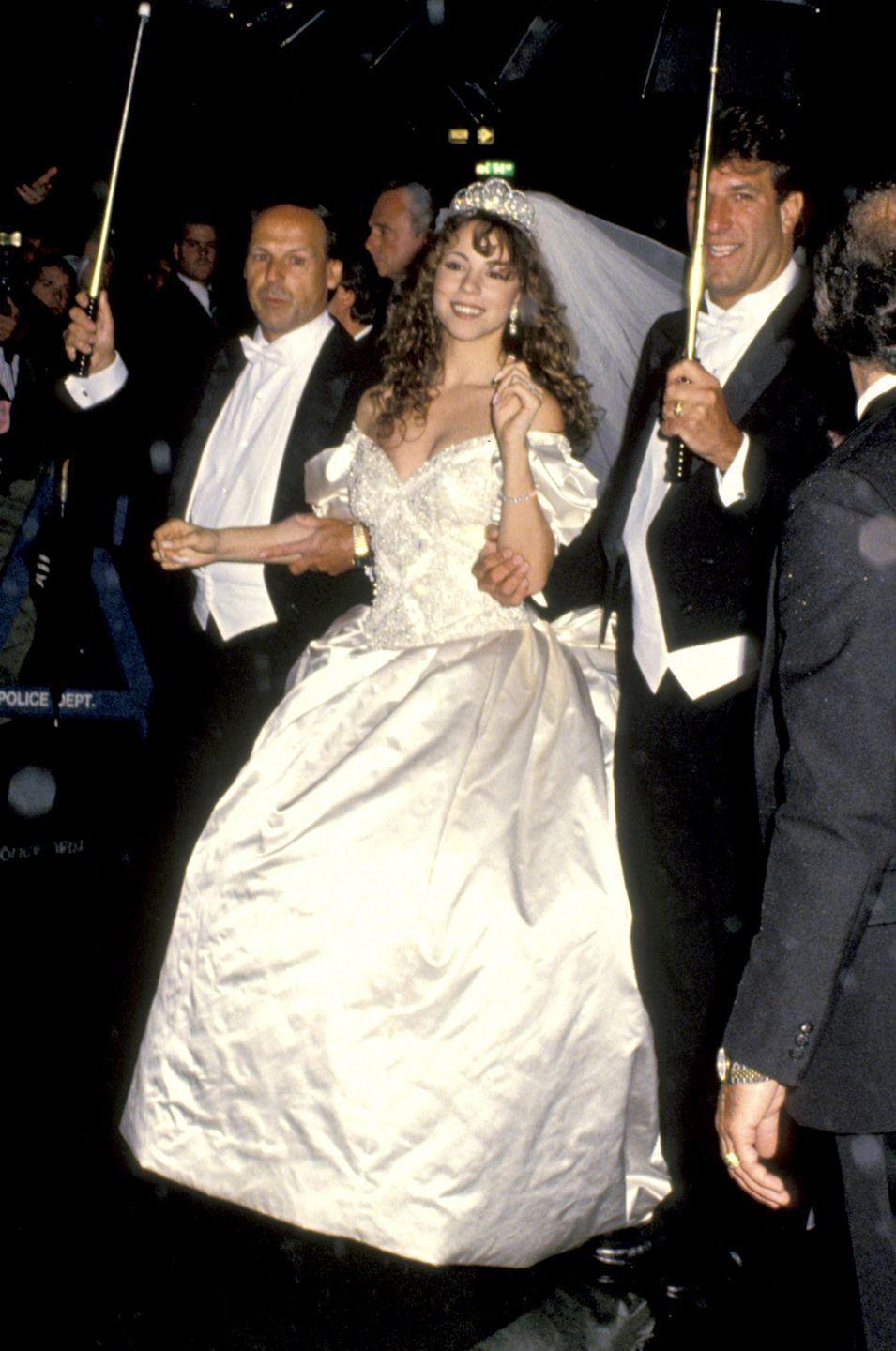 <p>In a lavish affair on June 5, 1993, singer Mariah Carey married Sony Music's Tommy Mottola wearing a massive $25,000 Vera Wang gown with a 27-foot-long train. That's right, <em>27 feet</em> of fabric. The couple divorced just four years later.</p>