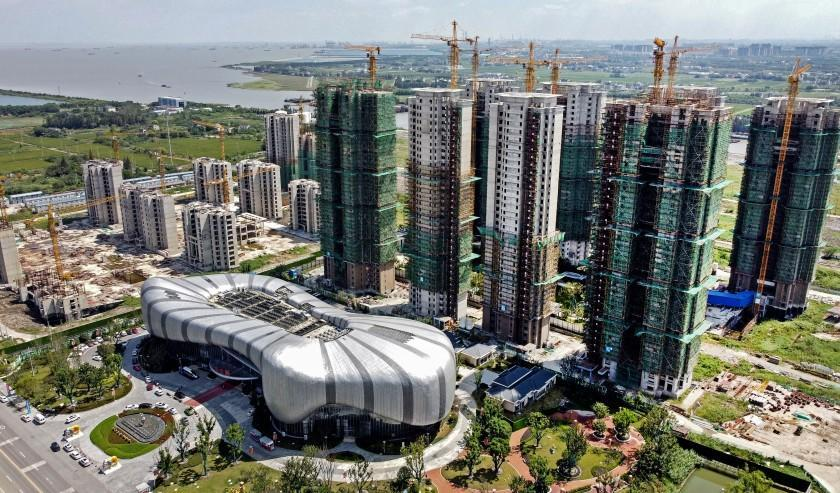 This aerial photo taken on September 17, 2021 shows the halted under-construction Evergrande Cultural Tourism City, a mixed-used residential-retail-entertainment development, in Taicang, Suzhou city, in China's eastern Jiangsu province. (Photo by Vivian LIN / AFP) (Photo by VIVIAN LIN/AFP via Getty Images)