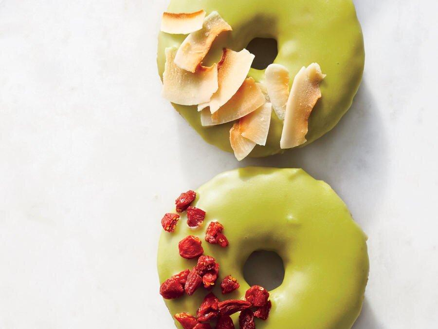 """<p>These easy baked donuts benefit from matcha in the batter and in the glaze, where it lends beautiful color. If you're unfamiliar with matcha, it's high-quality green tea that's ground into a fine powder. Matcha has a powerfully earthy, bitter flavor, so a little goes a long way. For the most vibrant color, seek out a reputable brand (some lower-quality brands have a dull, olive-green color). We recommend Maeda-en Matcha Green Tea Powder, culinary quality; Aiya Matcha, ceremonial grade; or Eden Matcha. We love the color and flavor of the coconut and goji berry garnishes; if you can't find goji berries, you can use dried cranberries instead.</p> <p><a href=""""https://www.myrecipes.com/recipe/matcha-glazed-donuts"""">Matcha-Glazed Donuts Recipe</a></p>"""