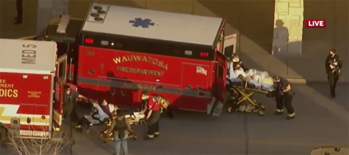 "In this image taken from video provided by WISN-TV, emergency crews place two people in waiting ambulances at the Mayfair Mall in Wauwatosa, Wis., on Friday, Nov. 20, 2020. A police dispatcher says officers are responding to ""a very active situation"" at the suburban Milwaukee mall. The dispatcher said she could not immediately provide further details. Witnesses told WISN-TV that they heard what they believed were eight to 12 shots. (WISN-TV via AP)"