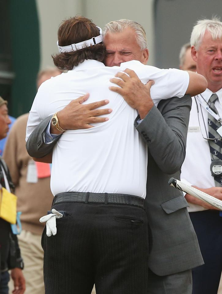 GULLANE, SCOTLAND - JULY 21: Phil Mickelson of the United States hugs manager Steve Loy after finishing the final round of the 142nd Open Championship at Muirfield on July 21, 2013 in Gullane, Scotland. (Photo by Andrew Redington/Getty Images)