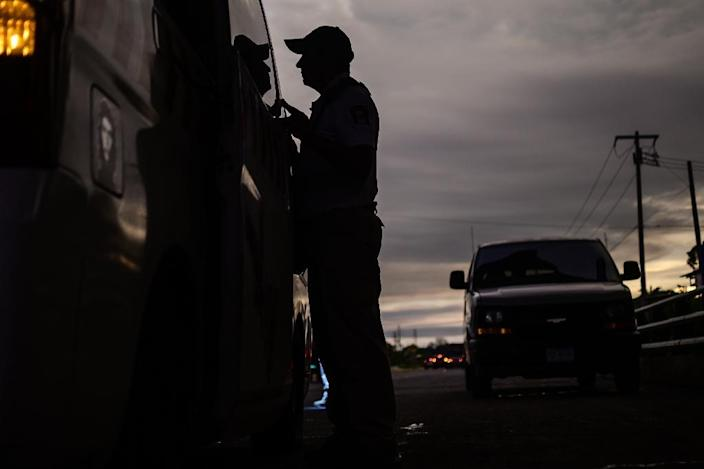 A Mexican immigration agent checks documents at a checkpoint in the outskirts of Tapachula, Chiapas state, Mexico (AFP Photo/PEDRO PARDO)