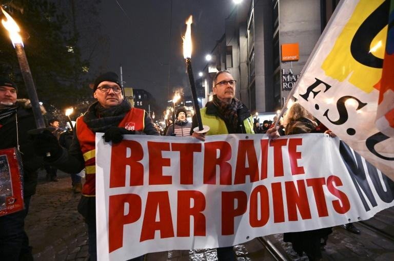 Protesters marched with torches in Strasbourg, eastern France, on Thursday against the French government's pension overhaul