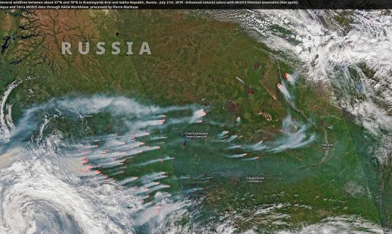 Satellite image processed by Pierre Markuse showing numerous wildfires burning in Russia just south of the Arctic Circle (Pierre Markuse/Creative Commons)