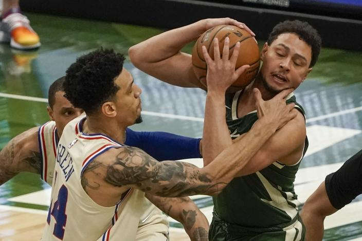 Philadelphia 76ers' Danny Green fouls Milwaukee Bucks' Bryn Forbes during the first half of an NBA basketball game Saturday, April 24, 2021, in Milwaukee. (AP Photo/Morry Gash)