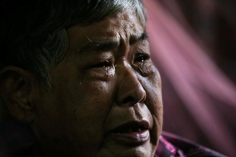 A tearful Ng Kwai Yee relates how she would take the bus from her home at Gunung View to their family home in Falim. — Picture by Farhan Najib