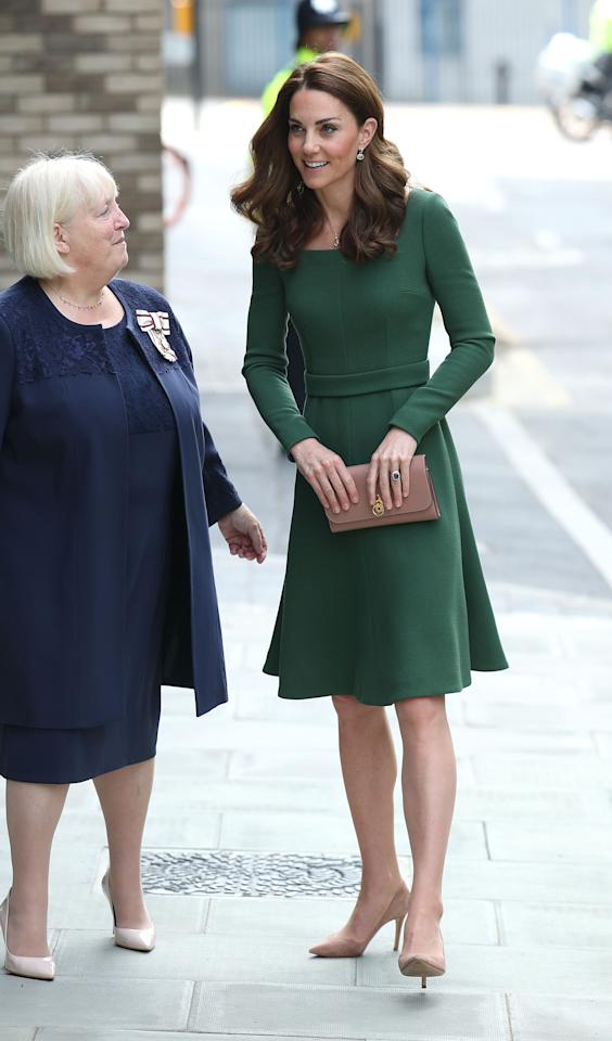 Kate donned a new forest green Emilia Wickstead dress (similar to a lavender number she owns) to open the new Anna Freud Centre of Excellence in London. She teamed it with her Gianvito Rossi 'praline' pumps and her Mulberry 'Amberley' clutch. [Photo: PA]