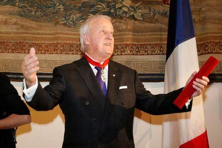 Former Canadian Prime Minister Brian Mulroney gestures after receiving the rank of Commander in the French Legion of Honour during a ceremony in Ottawa