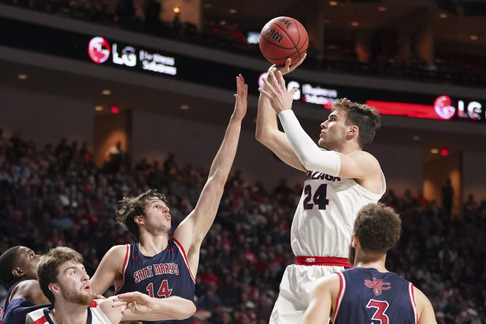 Gonzaga Bulldogs forward Corey Kispert (24) shoots the basketball against Saint Mary's Gaels forward Kyle Bowen (14) during a game on March 10. (Kyle Terada-USA TODAY Sports)