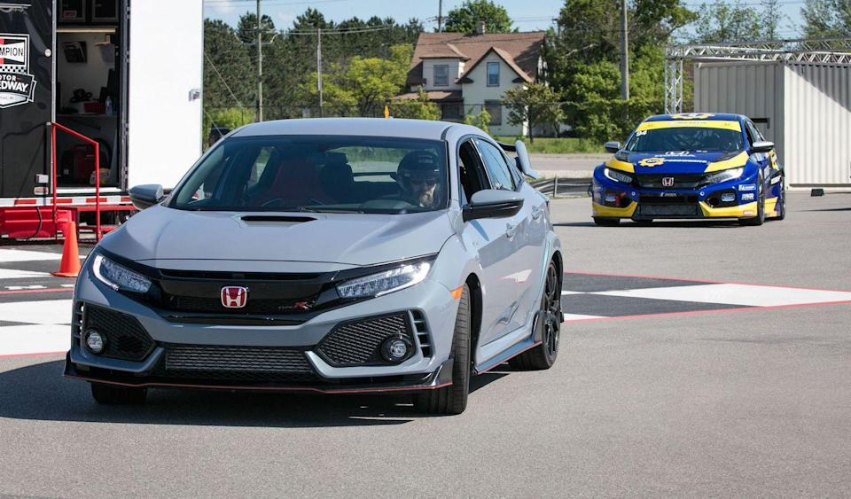 <p>The already wide Type R front fenders are punched out 2.9 inches to accept the race rubber.</p>