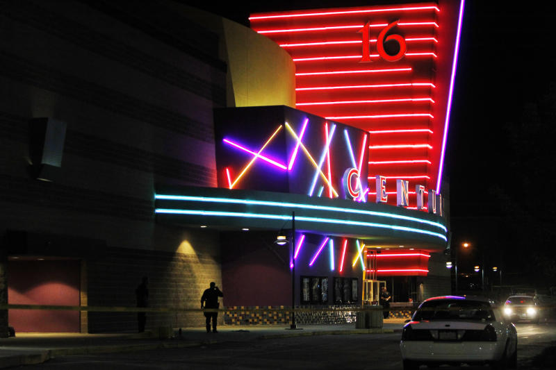 FILE - This July 20, 2012 file photo shows police outside of the Century 16 movie theatre where suspect James Holmes killed 12 people and wounded 70 during the screening of a Batman movie. Eight months later, Colorado became the only state outside the Democratic party's coastal bases to pass sweeping gun control laws. (AP Photo/Ed Andrieski, File)