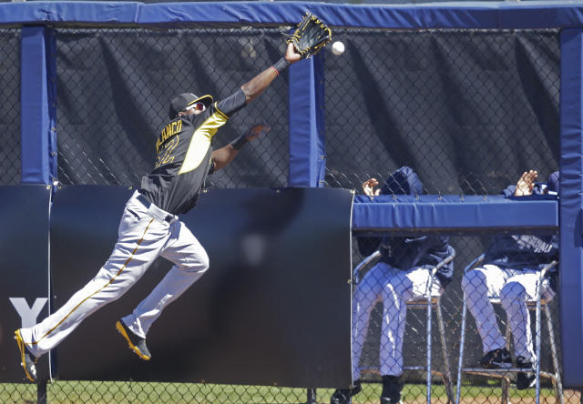 Pittsburgh Pirates right fielder Gregory Polanco (62) chases the ball on a triple hit by Tampa Bay Rays Logan Forsythe in the first inning of a exhibition baseball game in Port Charlotte, Fla., Saturday, March 8, 2014. (AP Photo/Gerald Herbert)