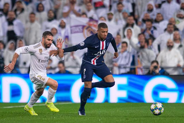 Kylian Mbappe (right) scored for PSG against Real Madrid on Tuesday, and is the apple of both clubs' eyes. (Photo by TF-Images/Getty Images)