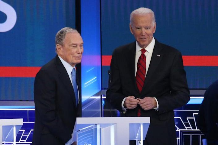 Democratic presidential candidates former New York City mayor Mike Bloomberg (L) and former Vice President Joe Biden speak during a break during the Democratic presidential primary debate at Paris Las Vegas on February 19, 2020 in Las Vegas, Nevada. (Photo by Mario Tama/Getty Images)
