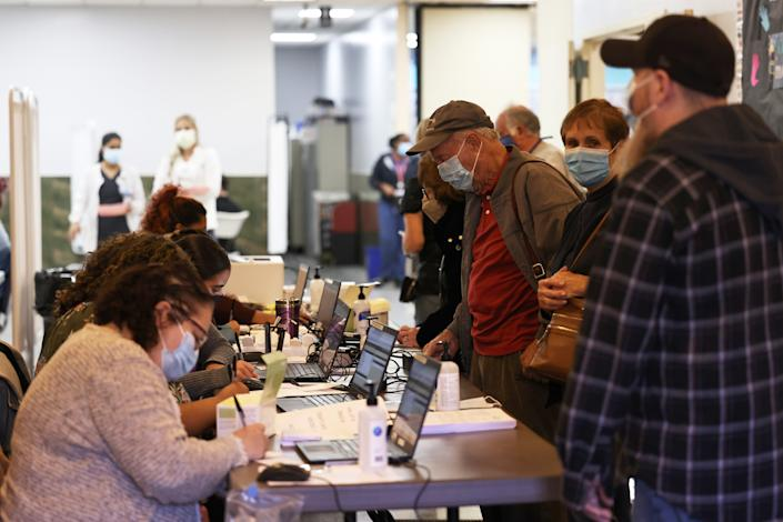 People are checked in at the Northwell Health pop-up coronavirus (COVID-19) vaccination site at the Albanian Islamic Cultural Center in Staten Island on April 08, 2021 in New York City. (Michael M. Santiago/Getty Images)