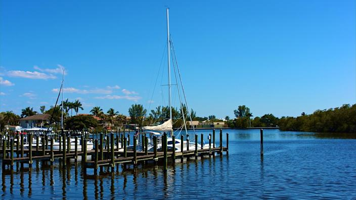 scenic view of boats at dock in canal in bonita springs, florida - Image.