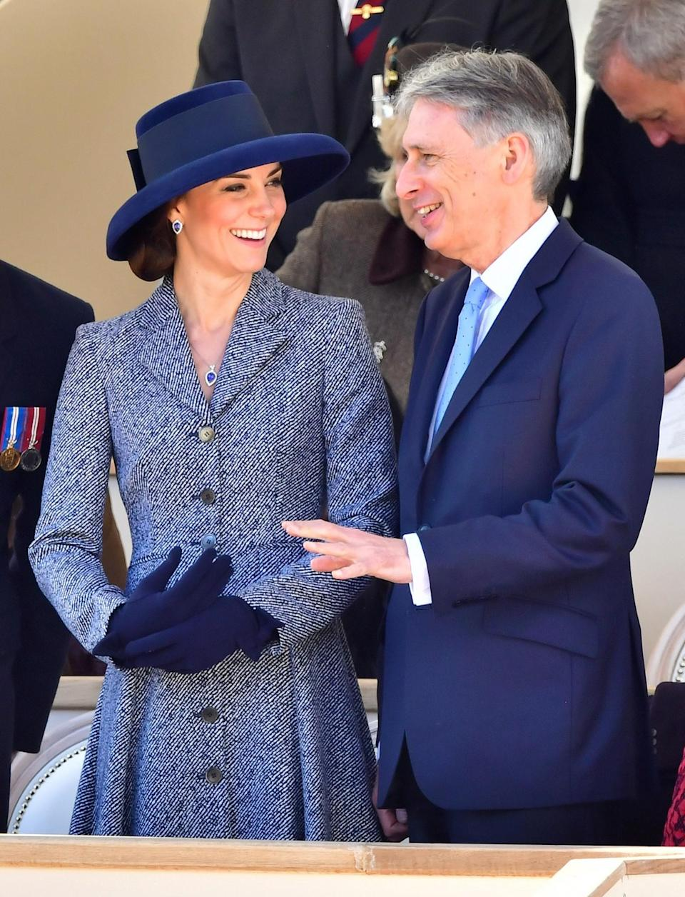 <p>The Duchess re-wore one of her favourite coat dresses for the unveiling of an Iraq and Afghanistan memorial in London. The light blue tweed design is by Michael Kors and was first worn by Kate back in 2014. On this occasion, she paired it with a navy wide-brimmed hat and matching wool gloves.<i>[Photo: PA]</i> </p>