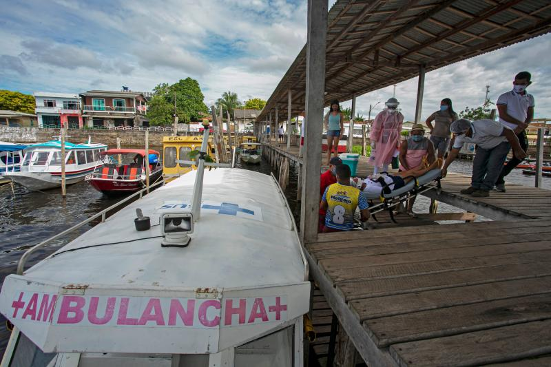 A COVID-19 patient is transfered by ambulance boat to a hospital in Breves city, Para state, after been hospitalized for five days in Melgaco, southwest of Marajo Island, in Brazil on June 10, 2020. (Photo by TARSO SARRAF / AFP) (Photo by TARSO SARRAF/AFP via Getty Images)