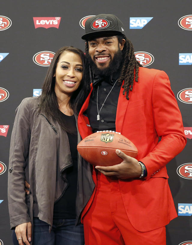 San Francisco 49ers new cornerback Richard Sherman, right, poses for a photo with his fiance Ashley Moss after answering questions during an NFL football news conference in Santa Clara, Calif., Tuesday, March 20, 2018. Sherman agreed to a three-year deal with the 49ers. (AP Photo/Tony Avelar)