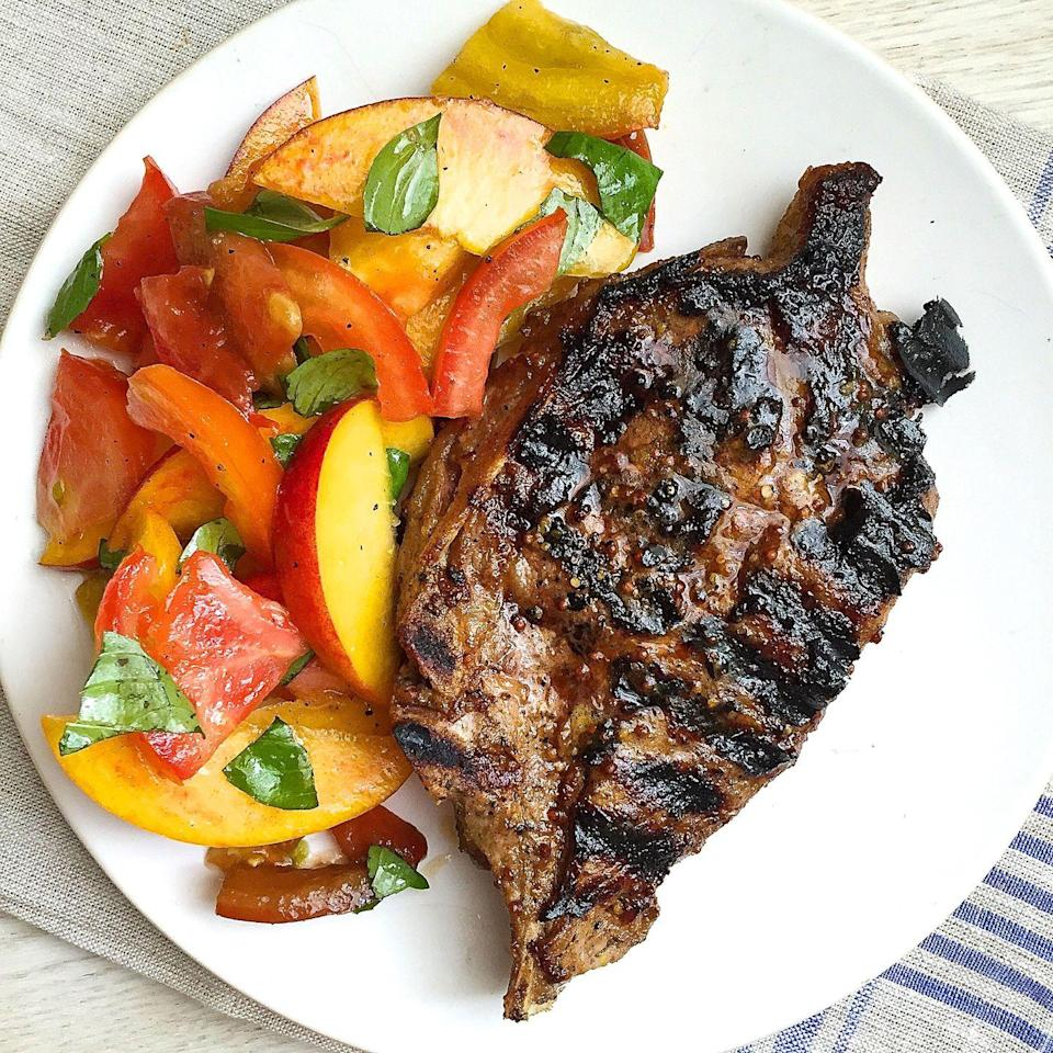 """<p>When you've got peaches and tomatoes, who needs lettuce?</p><p>Get the recipe from <a href=""""https://www.delish.com/cooking/recipe-ideas/recipes/a43497/dijon-grilled-pork-chops-recipe/"""" rel=""""nofollow noopener"""" target=""""_blank"""" data-ylk=""""slk:Delish"""" class=""""link rapid-noclick-resp"""">Delish</a>.</p>"""
