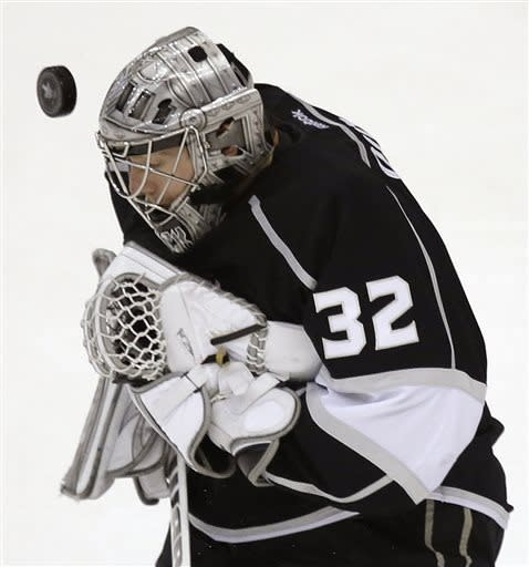 Los Angeles Kings goalie Jonathan Quick blocks a shot by the Chicago Blackhawks during the first period of Game 3 of the NHL hockey Stanley Cup playoffs Western Conference finals, Tuesday, June 4, 2013, in Los Angeles. (AP Photo/Jae C. Hong)