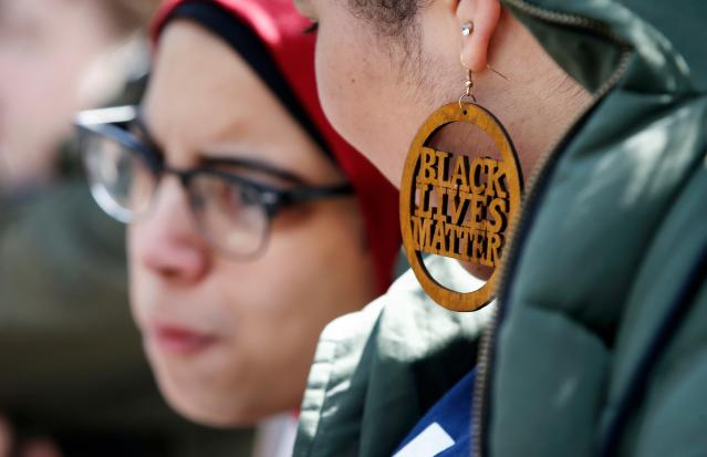<p>Harvard University student Cecilia Nunez wears a Black Lives Matter earring during a rally against school shootings and gun violence on the steps of Widener Library on campus in Cambridge, Mass., Friday, April 20, 2018. Protests were planned across the country Friday, on the 19th anniversary of the Columbine High School shooting. (Photo: Michael Dwyer/AP) </p>