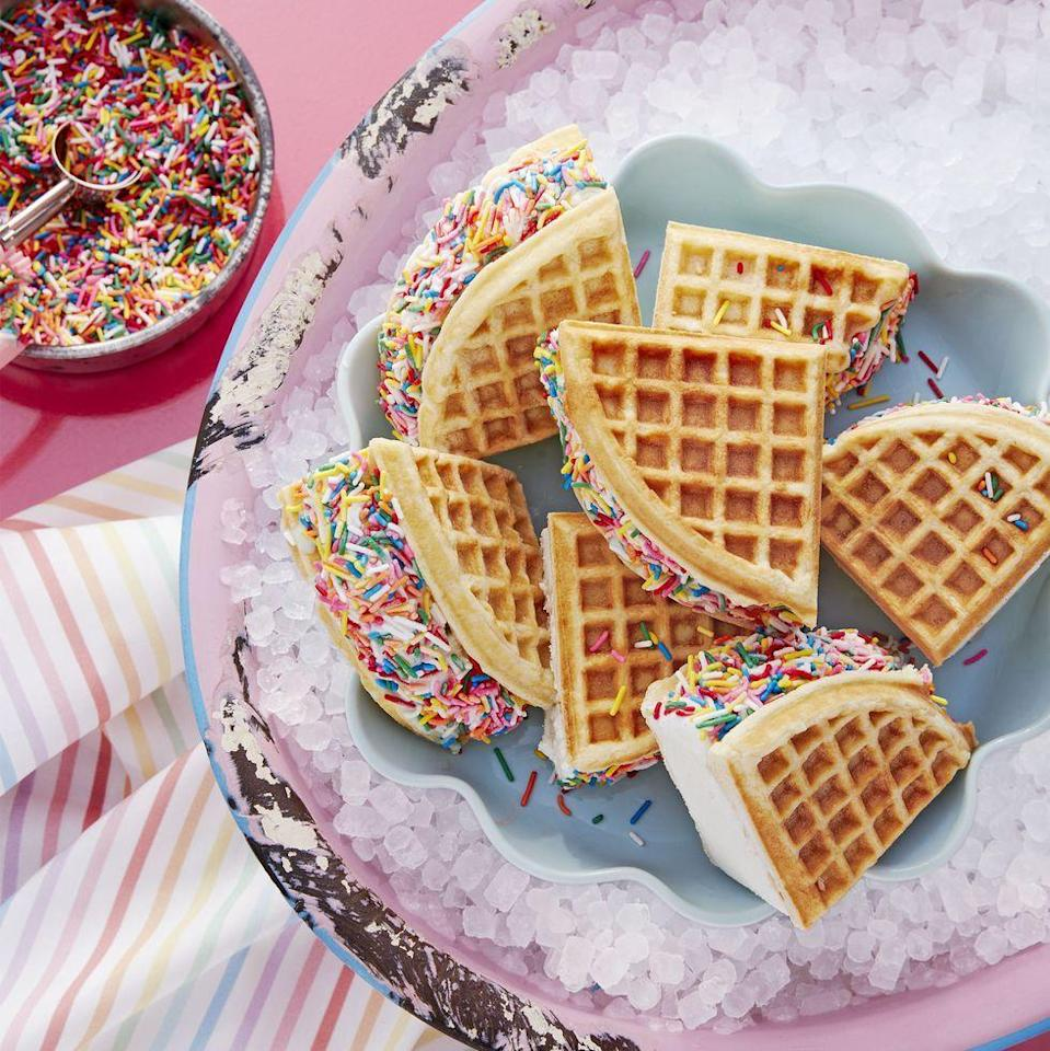 """<p>For the Mom who's a kid at heart, show her you care by whipping up a batch of ice cream sandwiches made with waffles and heaps of rainbow sprinkles.</p><p><a href=""""https://www.womansday.com/food-recipes/a32883702/rainbow-waffle-wiches-recipe/"""" rel=""""nofollow noopener"""" target=""""_blank"""" data-ylk=""""slk:Get the recipe for Rainbow Waffle-wiches."""" class=""""link rapid-noclick-resp""""><em>Get the recipe for Rainbow Waffle-wiches. </em></a></p>"""