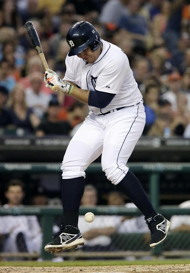 iDetroit Tigers' Miguel Cabrera reacts after being hit by a pitch from Seattle Mariners' Felix Hernandez during the third inning of a baseball game Saturday, Aug. 16, 2014, in Detroit. (AP Photo/Duane Burleson)
