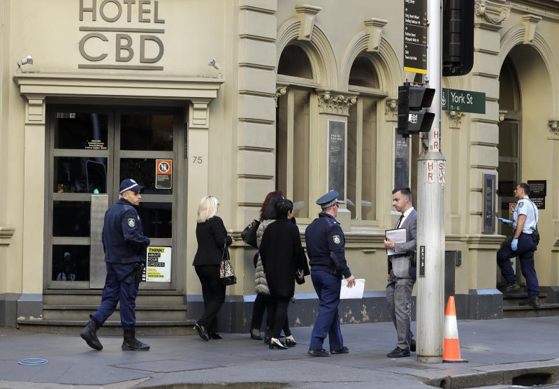 "Police work at a scene where a man attempted to stab multiple people in Sydney, Australia, Tuesday, Aug. 13, 2019. Police and witnesses say a knife-wielding man yelling ""Allahu akbar,"" or ""God is great,"" has attempted to stab several people before being arrested, with one person taken to a hospital. (AP Photo/Rick Rycroft)"
