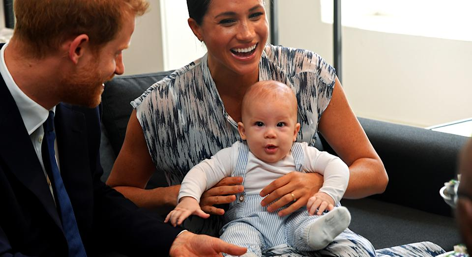 Baby Archie attended his first royal engagement in South Africa with the Duke and Duchess of Sussex in adorable striped dungarees. [Photo: Getty]
