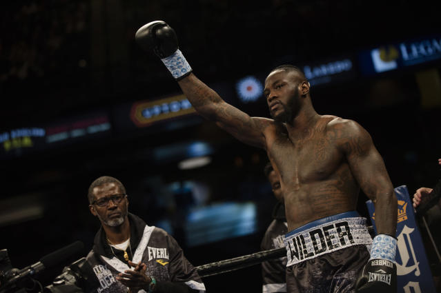 Deontay Wilder raises his glove before his WBC heavyweight title boxing bout against Gerald Washington in February. (AP)