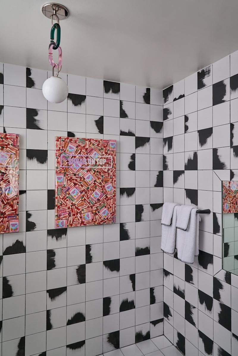 Want to do up your bathroom with the same elements? The pendant is by Trueing, the towels are by Weezie, and the sweet art is by Robyn Blair. Plus, the incredible tilework is a hand-painted touch by Heather Jozak Studios, who did the wall treatment too.