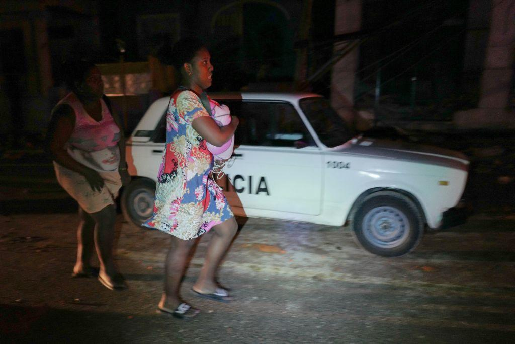 <p>Cuban residents run for help in the tornado-hit Luyano neighbourhood in Havana early on Jan. 28, 2019. A tornado hit several neighborhoods in Havana overnight on Jan. 28, disrupting electrical power and damaging buildings and cars. Cuba's President Miguel Díaz-Canel says at least three people are dead and 174 have been injured. (Photo from Adalberto Roque/AFP/Getty Images) </p>