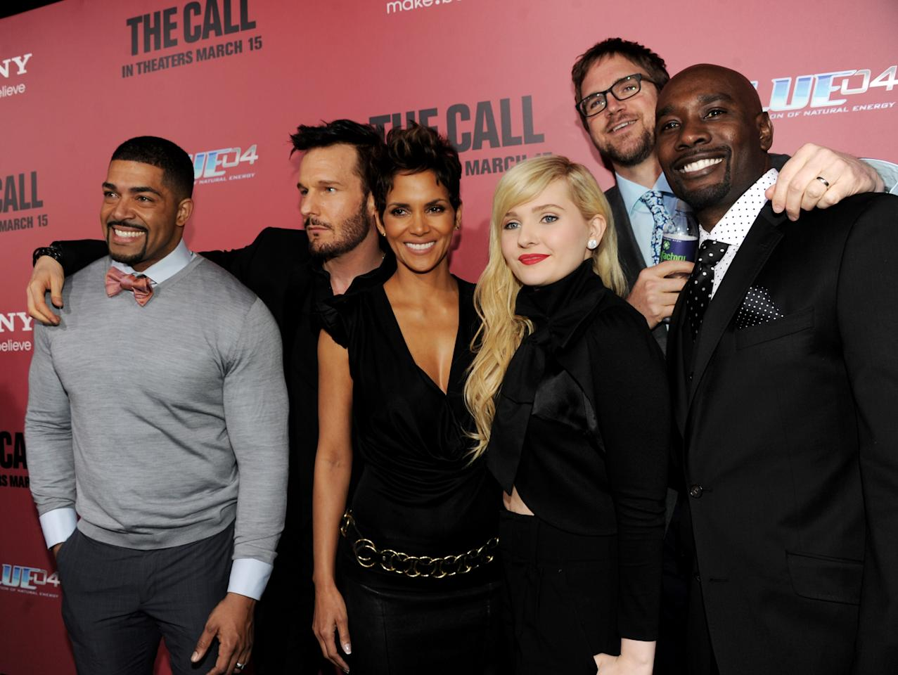 """LOS ANGELES, CA - MARCH 05:  (L-R) Actors David Otunga, Michael Eklund, Halle Berry, Abigail Breslin, director Brad Anderson and actor Morris Chestnut arrive at the premiere of Tri Star Pictures' """"The Call"""" at the Arclight Theatre on March 5, 2013 in Los Angeles, California.  (Photo by Kevin Winter/Getty Images)"""