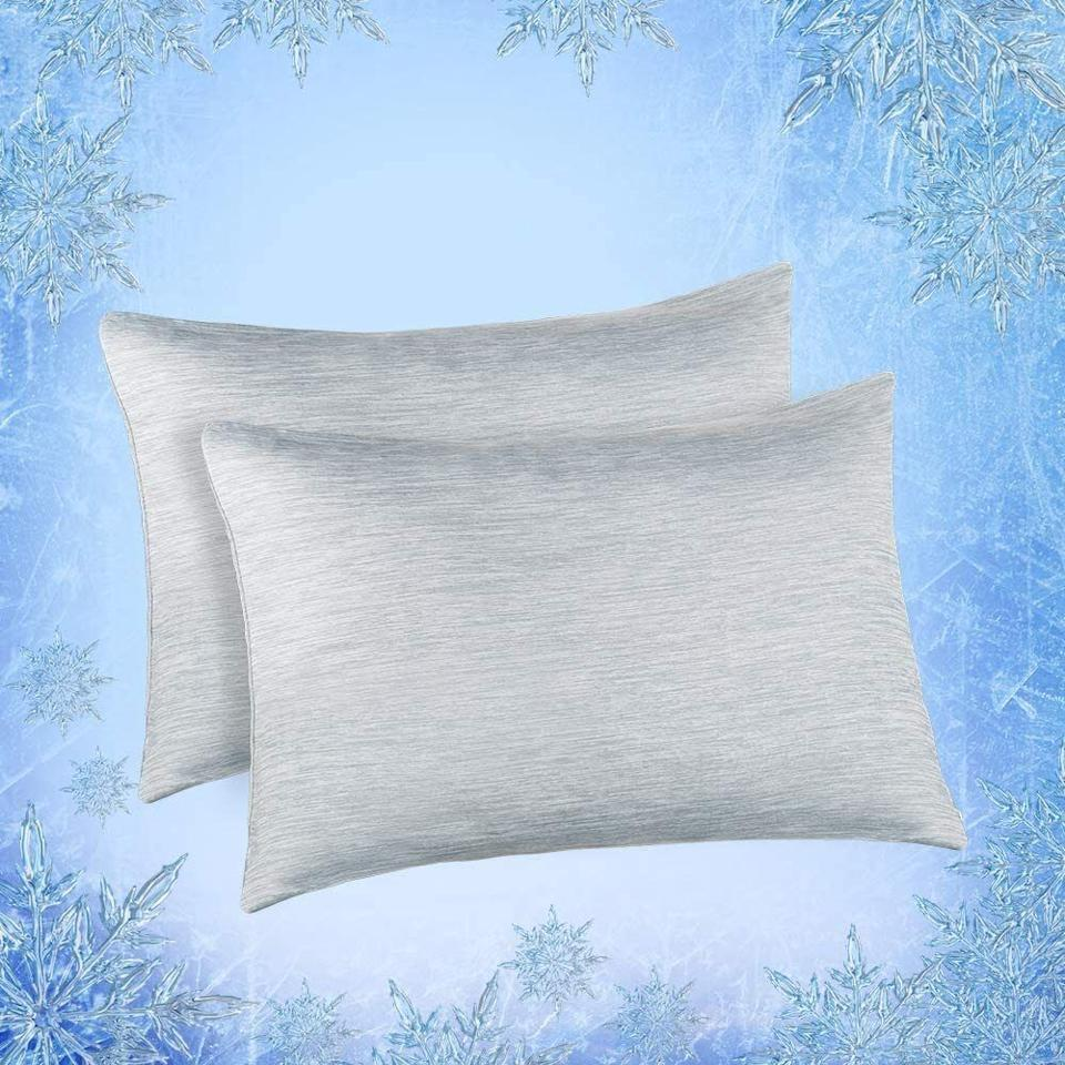 """It featuresone side designed in a state-of-the-art Japanese cooling fabric and the other side in 100% breathable cotton — basically, you'll always know which is the cool side of the pillow.<br /><br /><strong>Promising review:</strong>""""Best...Pillowcases...Ever!! I run hot all the time, especially at night. This really helps to keep me cool at night. I fall asleep, stay asleep, and wake up refreshed. The cool side of the pillow is always your side of the pillow! I actually sometimes get cold during the night. If you wake up in the middle of the night sweating, you need to get this!"""" — <a href=""""https://www.amazon.com/gp/customer-reviews/RW2WYT4L95JW5?&linkCode=ll2&tag=huffpost-bfsyndication-20&linkId=ef9dae48a493a8ffe38aa9adf6904904&language=en_US&ref_=as_li_ss_tl"""" target=""""_blank"""" rel=""""noopener noreferrer"""">Kim</a><br /><br /><strong><a href=""""https://www.amazon.com/Elegear-Cooling-Pillowcases-Japanese-Breathable/dp/B07TMF54XC?th=1&linkCode=ll1&tag=huffpost-bfsyndication-20&linkId=0f63ce0af0df19ff85fa5c985420d4b3&language=en_US&ref_=as_li_ss_tl"""" target=""""_blank"""" rel=""""noopener noreferrer"""">Get a set of two from Amazon for $25.89+ (available in two sizes and seven colors).</a></strong>"""