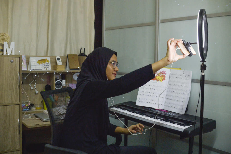 A music teacher teaches an online piano class during the movement control order (MCO) in Shah Alam January 24, 2021. — Picture by Miera Zulyana