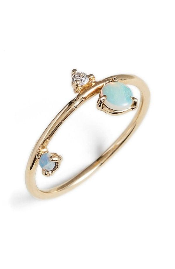 """<p>The <a href=""""https://www.popsugar.com/buy/Counting-Collection-Three-Step-Balloon-Opal-amp-Diamond-Ring-531841?p_name=Counting%20Collection%20Three-Step%20Balloon%20Opal%20%26amp%3B%20Diamond%20Ring&retailer=shop.nordstrom.com&pid=531841&price=588&evar1=fab%3Aus&evar9=7954958&evar98=https%3A%2F%2Fwww.popsugar.com%2Fphoto-gallery%2F7954958%2Fimage%2F7955465%2FCounting-Collection-Three-Step-Balloon-Opal-Diamond-Ring&list1=shopping%2Cwedding%2Cjewelry%2Crings%2Cbride%2Cengagement%20rings%2Cfashion%20shopping&prop13=api&pdata=1"""" rel=""""nofollow noopener"""" class=""""link rapid-noclick-resp"""" target=""""_blank"""" data-ylk=""""slk:Counting Collection Three-Step Balloon Opal & Diamond Ring"""">Counting Collection Three-Step Balloon Opal & Diamond Ring</a> ($588) features two stones and a diamond that are both delicate and beautiful. </p>"""